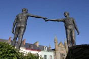 "1992 - ""Reconciliation/Hands Across the Divide"" Statue, west end of Craigavon Bridge, Londonderry (Northern Ireland). Produced by Maurice Harron. An image of the statue illustrates the website and brochures of the ""Ulster Project"" in Oak Ridge, Tennessee (USA)."