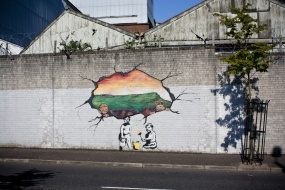 """Hole in the Wall,"" Northumberland Street, West Belfast (Northern Ireland). On the Falls/Shankill peace line. ""By Danny Devenny & Mark Ervine à la [graffiti artist] Banksy."""