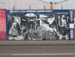 "August 21, 2009 - ""Guernica,"" Falls Road, Belfast (Northern Ireland). ""Gasta.com [a UK search engine] contnues to support community artists in Belfast with a revitalization of the Art forPeace mural of Guernica in the Falls road area of Belfast near Bombay street where the troubles started in 1969. The Mural was painted by Danny Devenny with a host of other artists including Mark Irvine, Robert Ballagh, Doc from Derry & many international visitors."